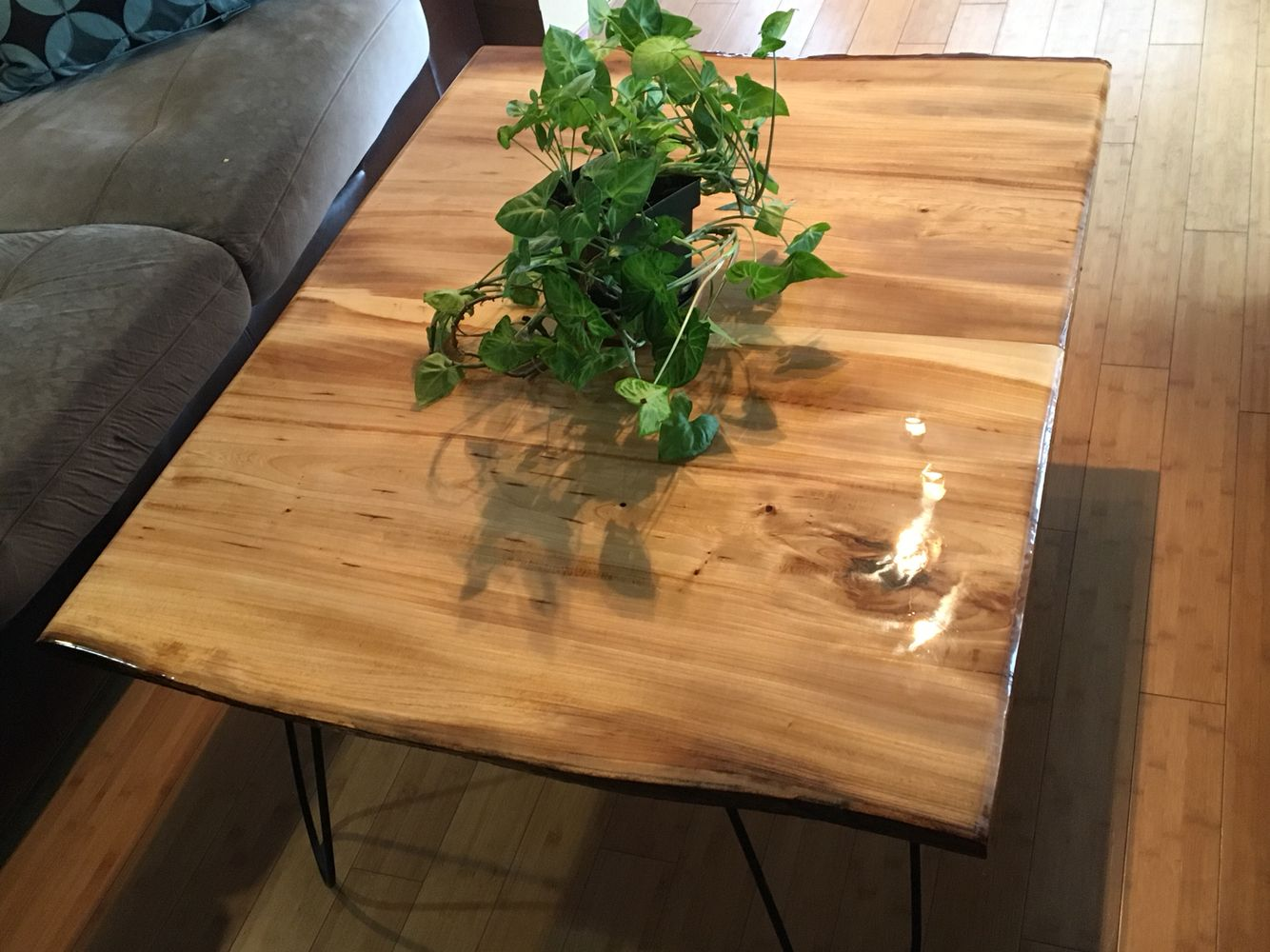 Coffee table I made from elm wood, bar top epoxy finish and cotter pin legs.  Go for about $600