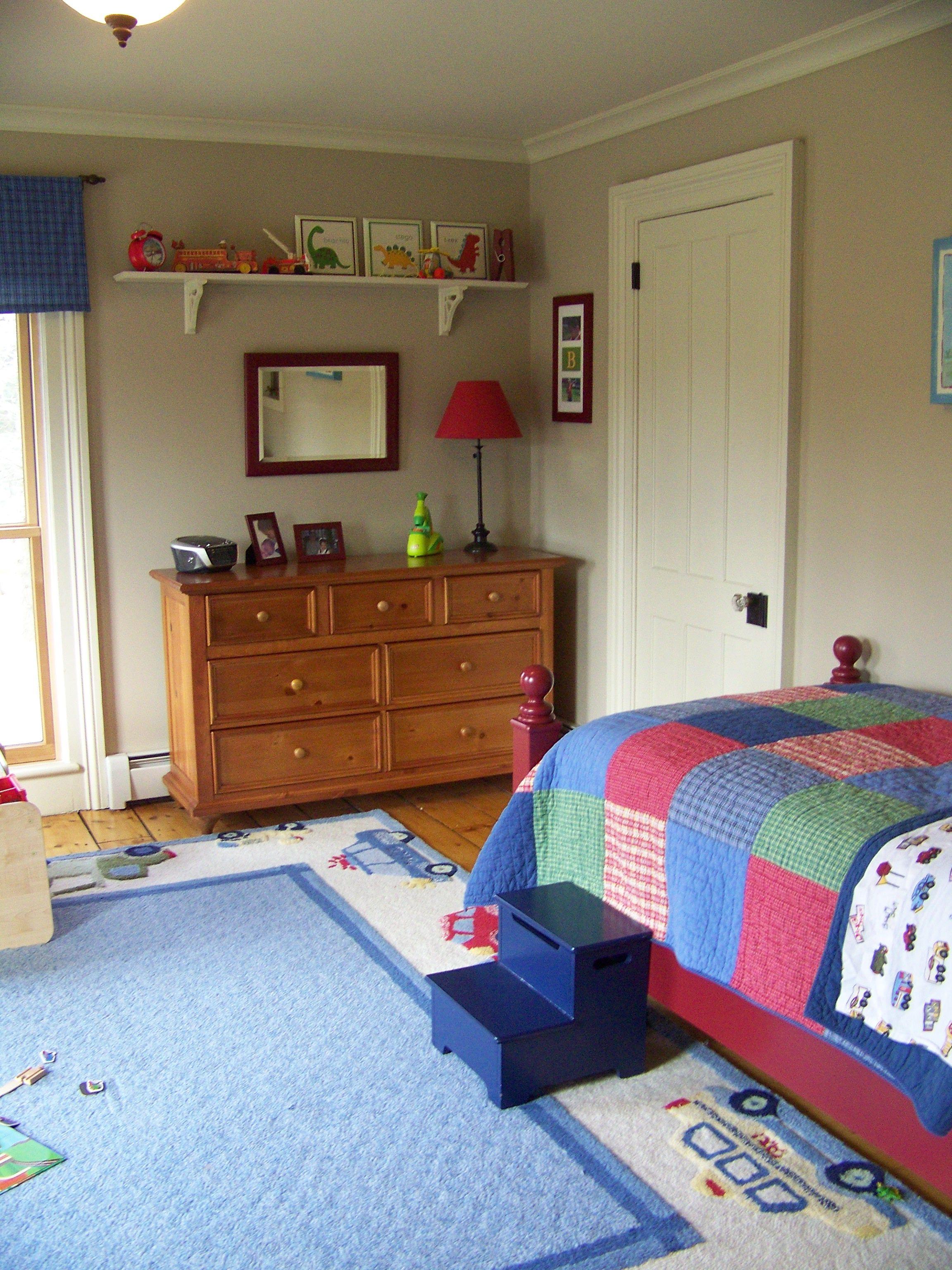 enjoyable bedroom interior design. Minimalist Bedroom Interior Design with Colorful bed and Wooden Vanity  Drawers also Wall Mounted Shelves