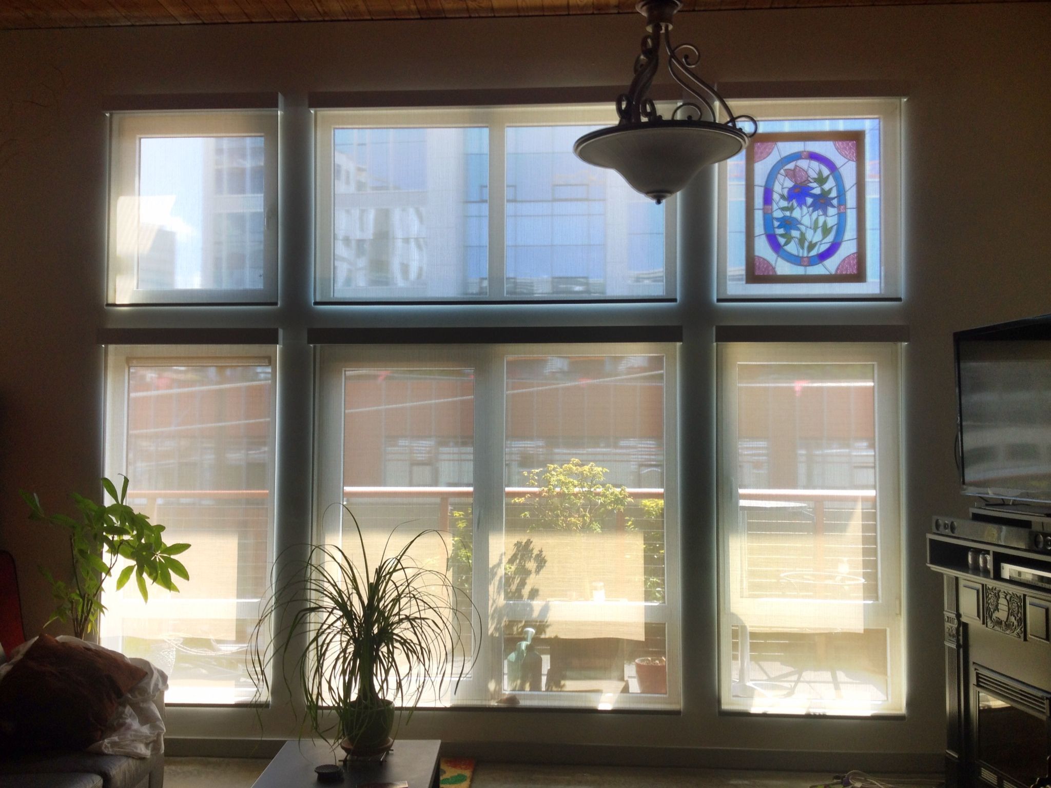 A Wall Of Outside Mount Motorized Solar Shades With Aluminum Fascia