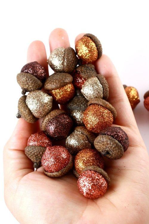 Glitter acorns. Good vase filler for a fall wedding :)