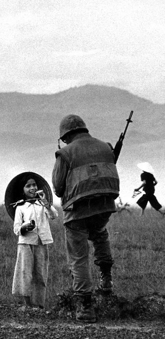 """Vietnam, 1967. 'In an attempt to impose the American value system on the Vietnamese, the Marines concluded operations called, in Orwellian Newspeak, """"county fairs."""" Villagers were taught how to wash their children, made to watch Disney films on hygiene, had their teeth pulled, were given real toilets with seats, and were introduced to filter tips.' (from previous pinner) // Philip Jones Griffith"""