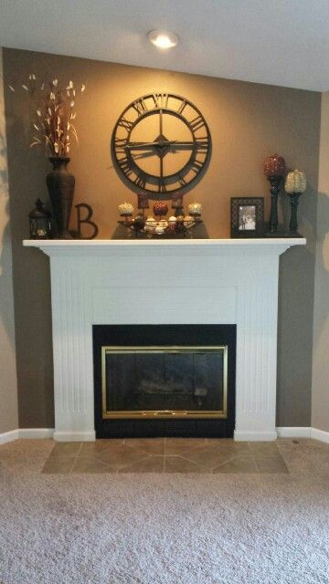 How to Professionally Decorate a Mantel Tall vases Mantle and