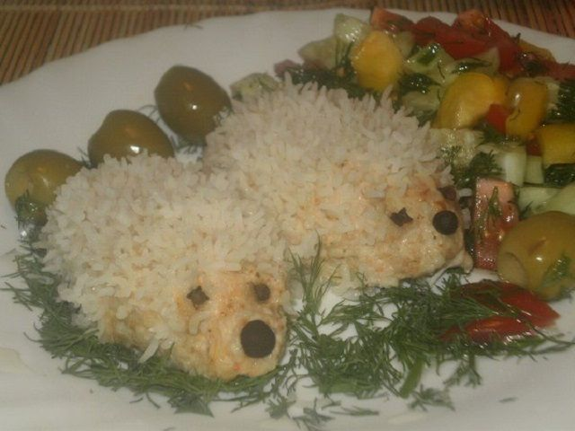 Hedgehogs of minced meat with rice and tomato paste