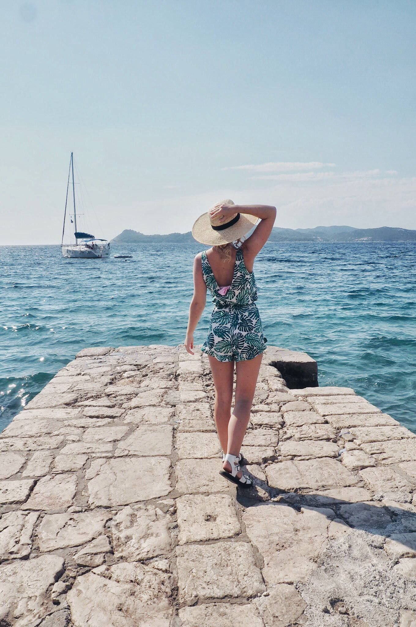 e6b1f7254e709 Pick of the best holiday outfits this summer, including high-waisted bikinis,  tropical print playsuits and pretty sundresses. Make your next adventure  your ...