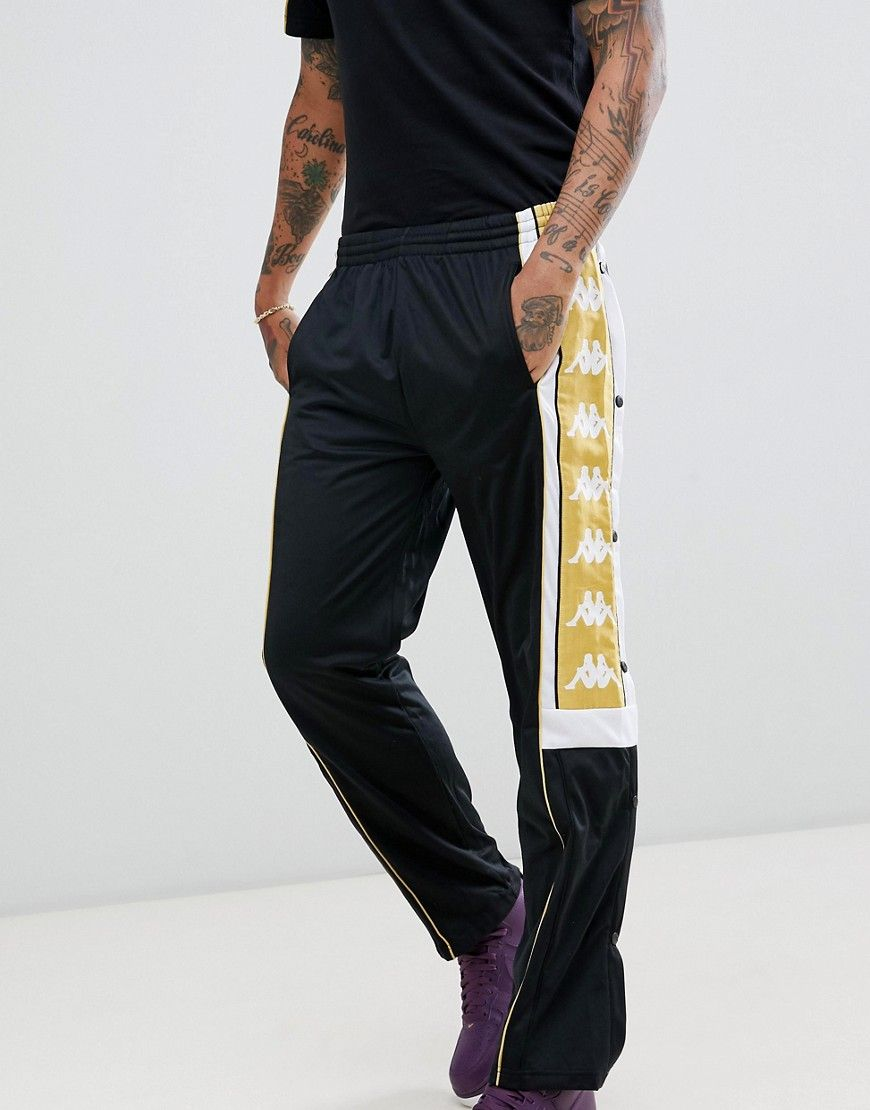 a522fb4c1e KAPPA JOGGERS WITH POPPER HEM AND LARGE LOGO TAPING IN BLACK & GOLD ...