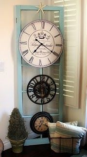 French door and clocks = wall art. Would be cute hung horizontally too over a buffet or high ledge.