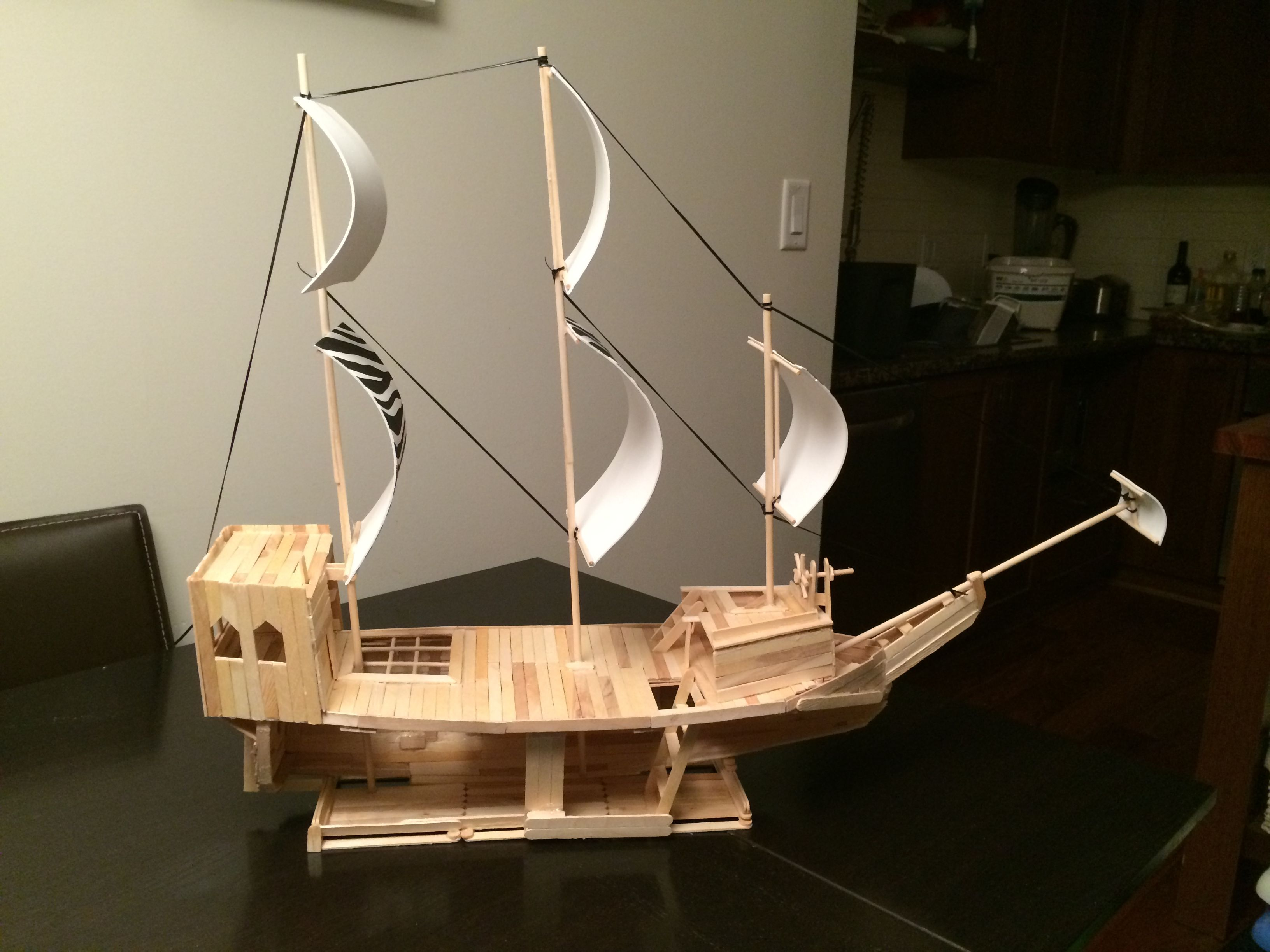 Angle #2 - Pirate ship made out of popsicle sticks, wooden dowels and some foam! Does not float ...