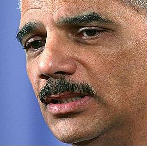 eric holder says the justice department will resume probe of