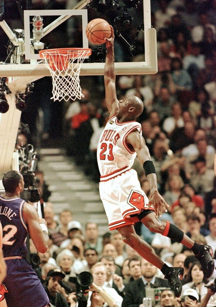 Powerless Karl Malone Of Utah Jazz Left Can Only Watch As Jordan Rises Above Him To Get The Dunk