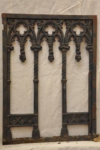 Love the Gothic elegance of this  antique iron window grill. I actually like it as a decor piece just on the wall! From La Caze.