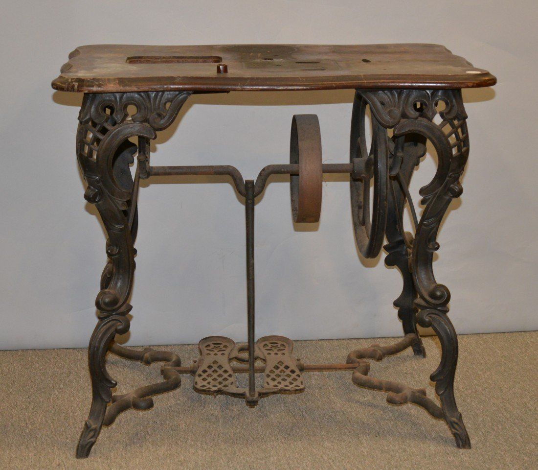 VICTORIAN CAST IRON FLORENCE SEWING MACHINE TABLE, the double treadle feet with star shape heel logo; height: 27 inches