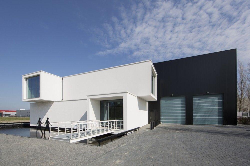 Sanibell roosros architecten contenedores y caba as for Diseno de oficinas con contenedores