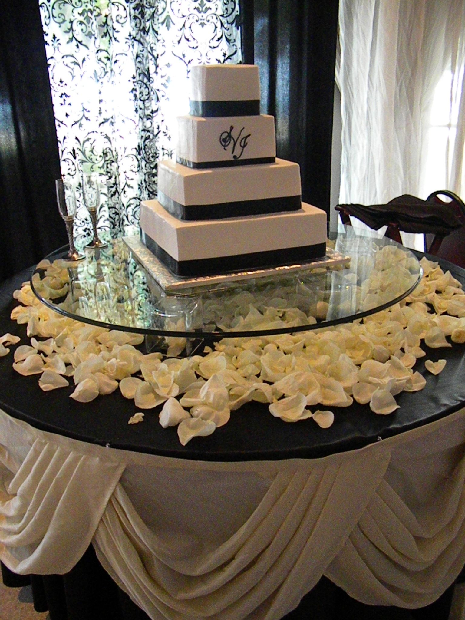 Love this cake stand set up - The glass, candles, flower petals, and ...