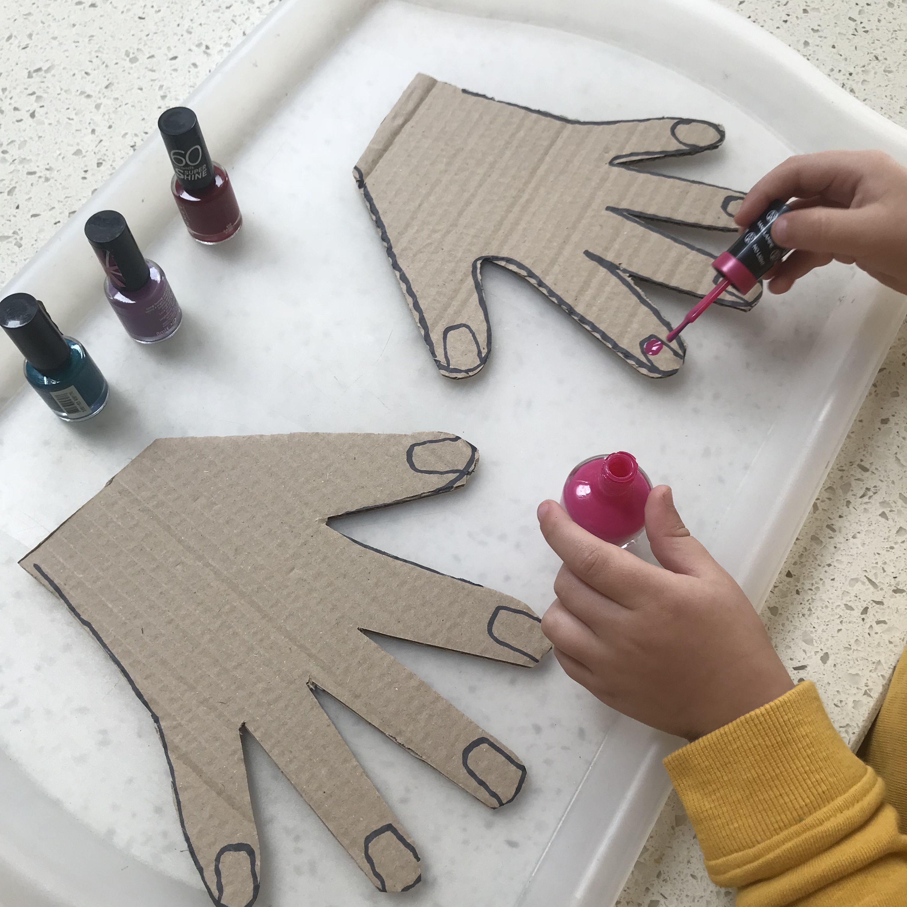Nail painting into cardboard cut out hands! Great for hand eye coordination, pretend play and creative development