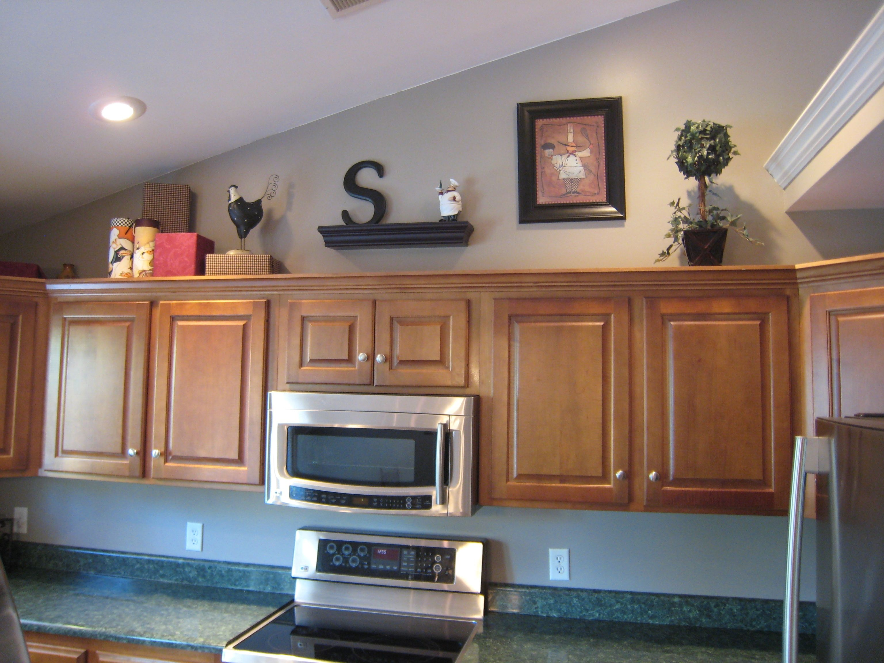 Decorating above kitchen cabinet space kitchen cabinets