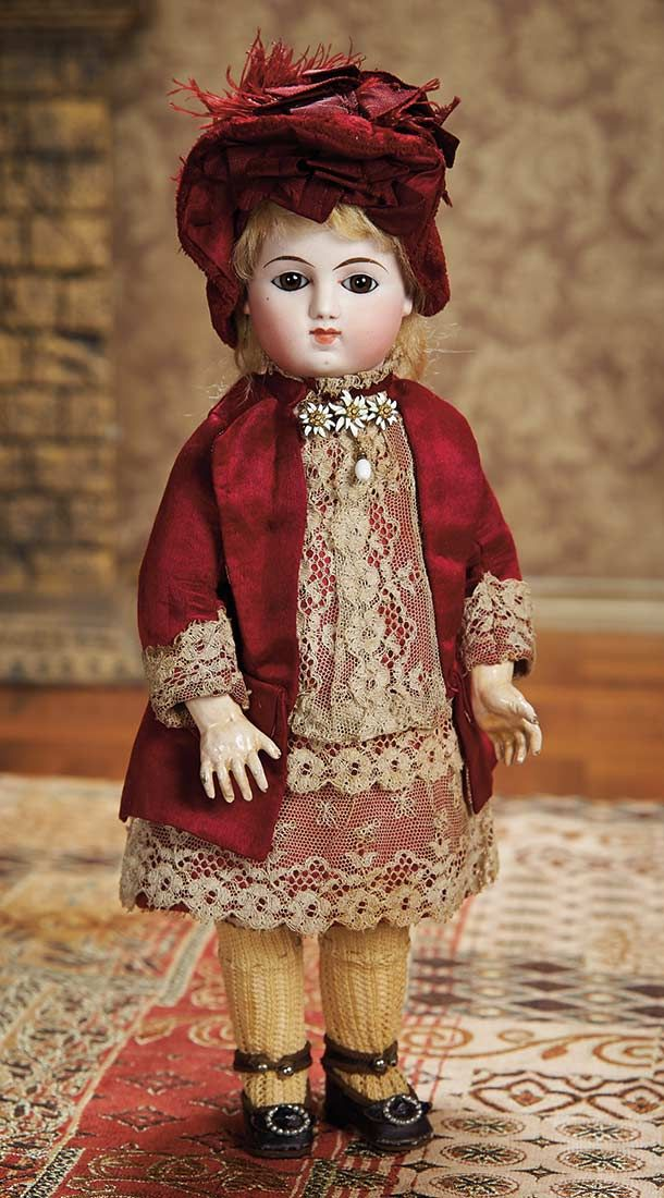 "Rare 12"" German bisque bébé wearing original burgundy silk dress with lace trim, by unknown Sonneberg maker, marked 2. This bébé was presented to compete with the popular French bébés of the era."