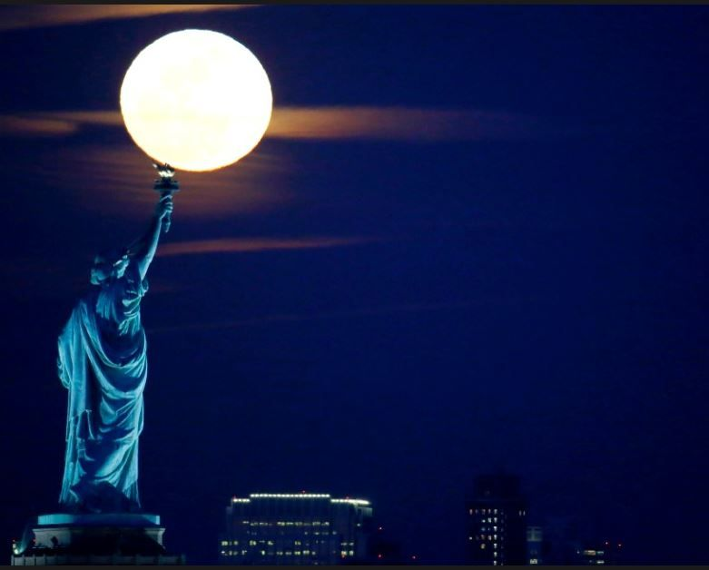 Lady Liberty holding the Moon