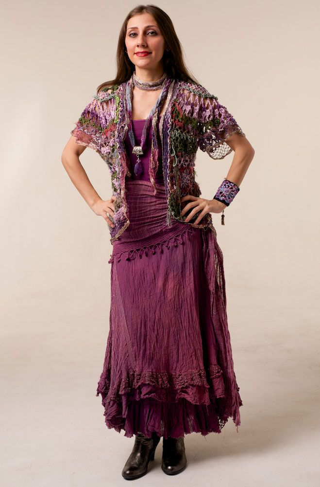 Try a knitted and colorful vest over solid colors, it's beautiful! Dare to be different!