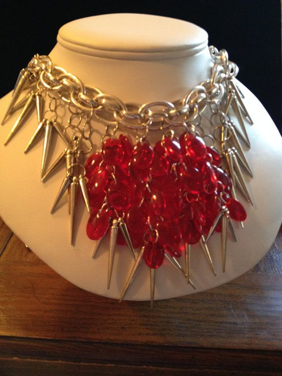 Silver spikes and red glass beads by HandScreativedesigns on Etsy, $30.00