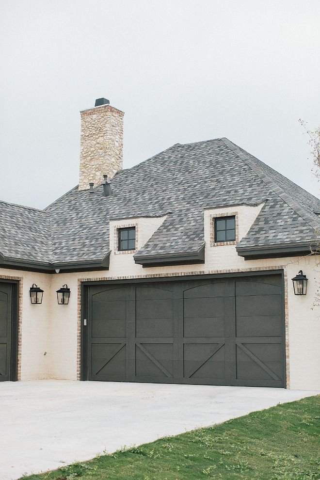 A Soft Gray Garage Door With Panel Design And Light Fixtures Create A  French Country Vibe