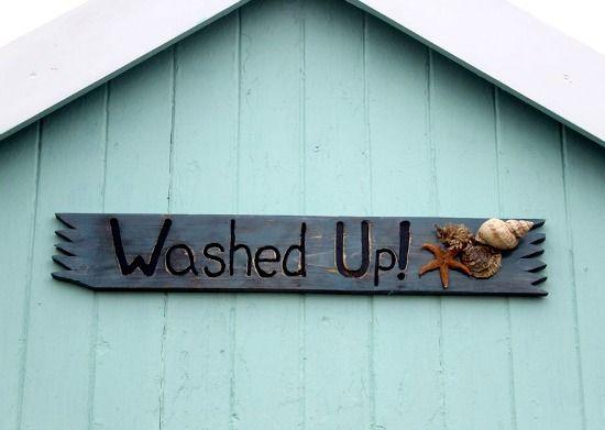 Ideas for house sign from the British beach huts! http://beachblissliving.com/beach-hut-rentals/