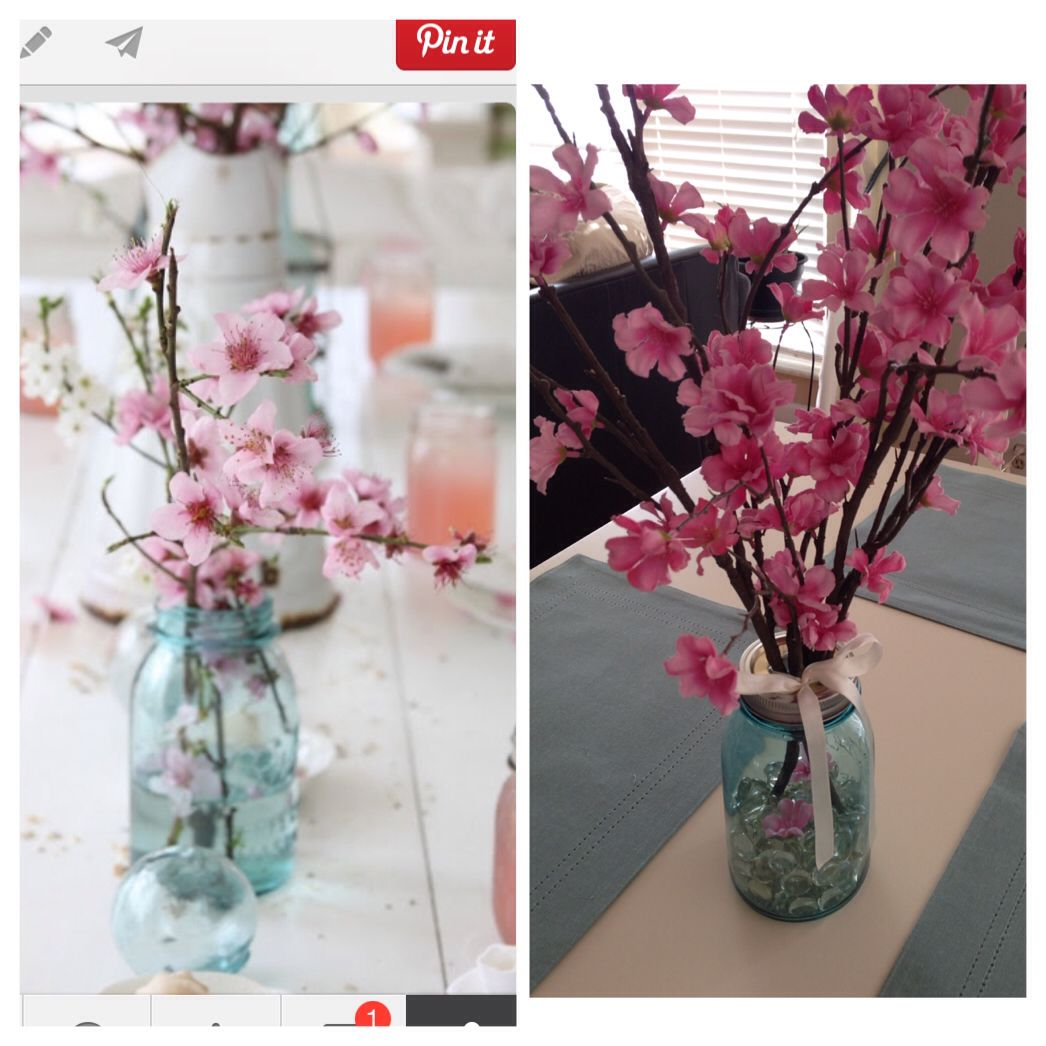 Cute and easy diy spring centerpiece blue mason jar glass vase blue mason jar glass vase filler and faux pink cherry blossom stems from target add a little charm with a bow but also holds the stems reviewsmspy