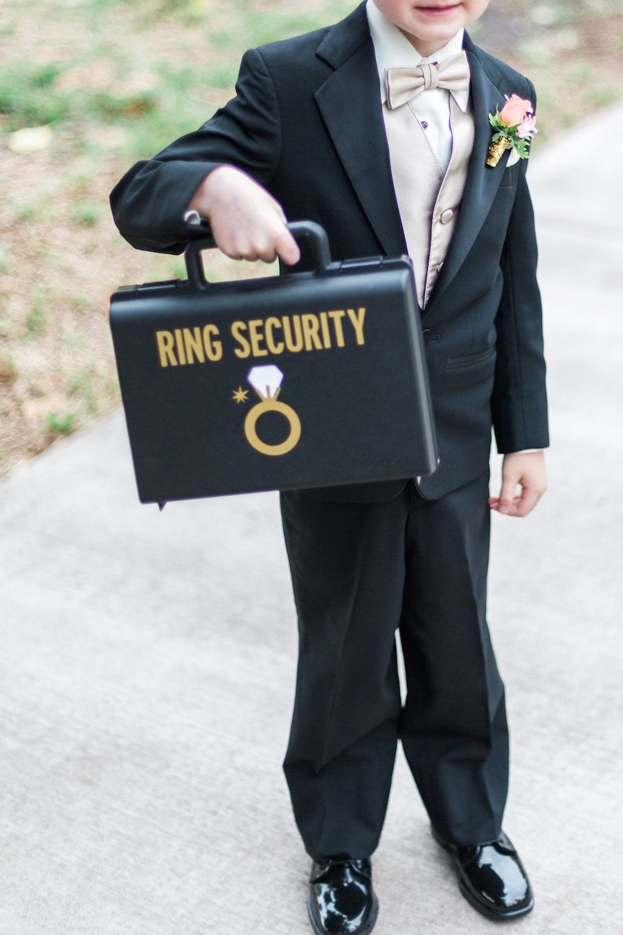 Black Gold and Coral Downtown St Pete Wedding Ring security