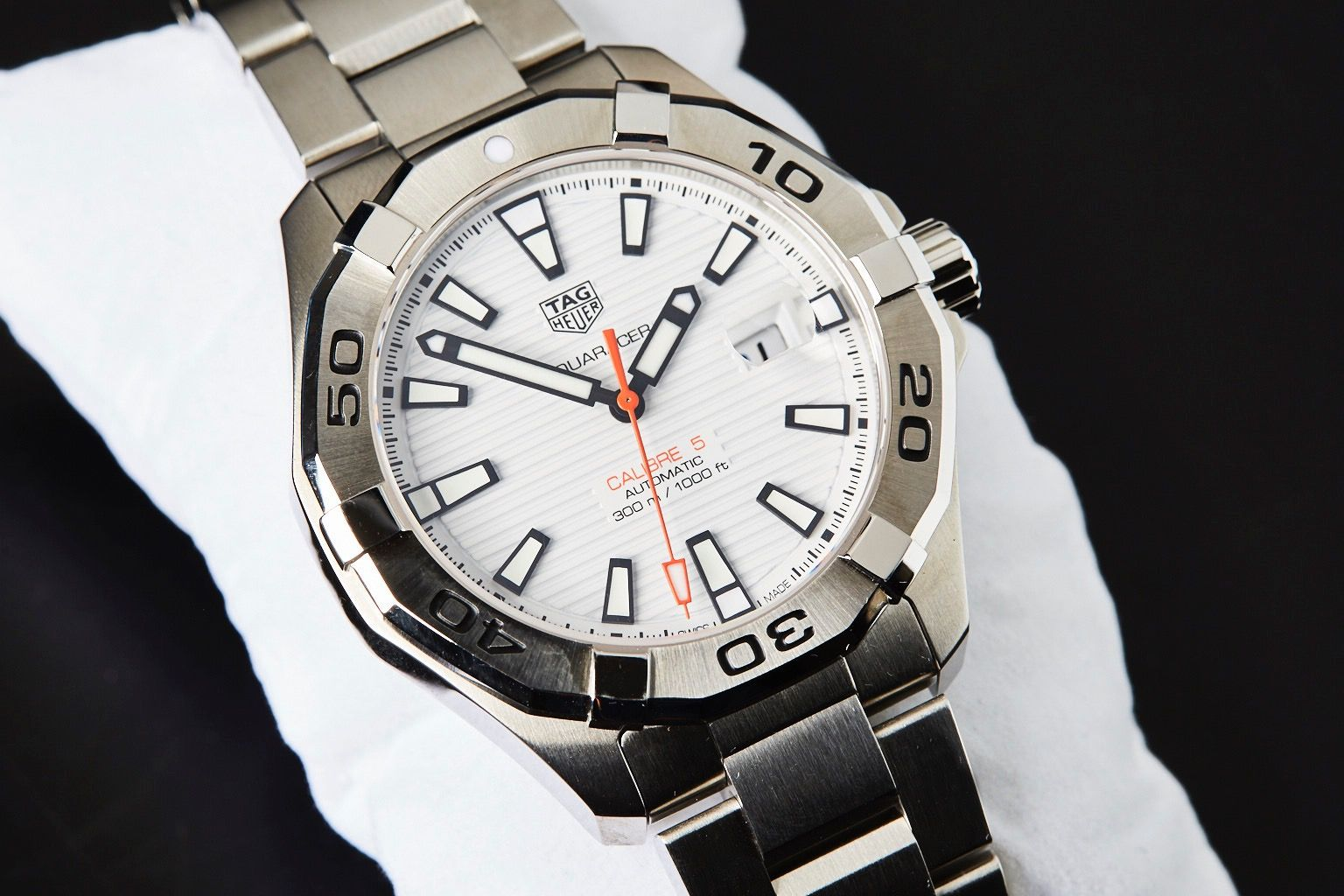 This Tag: TAG Heuer Aquaracer Calibre 5 White Dial Orange Hand