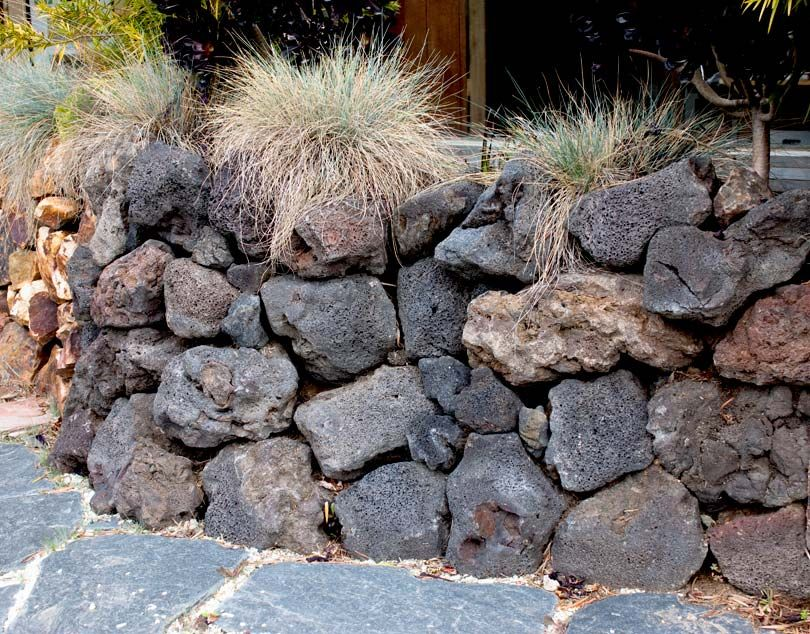 lava rock retaining wall Google Search landscape Pinterest