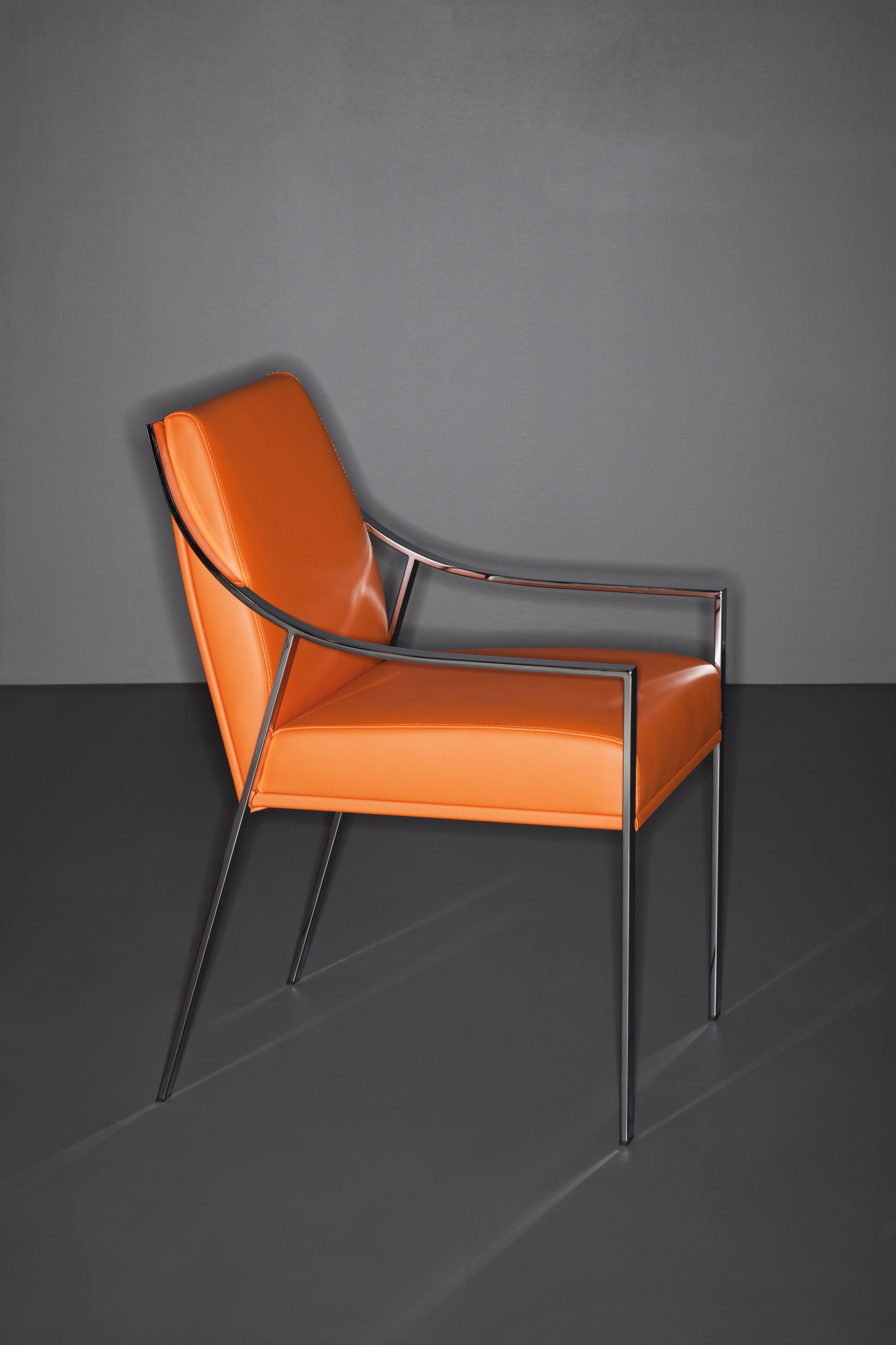 Aileron Chair With Orange Leather For Holly Hunt. Available At The DD  Building Suite 503