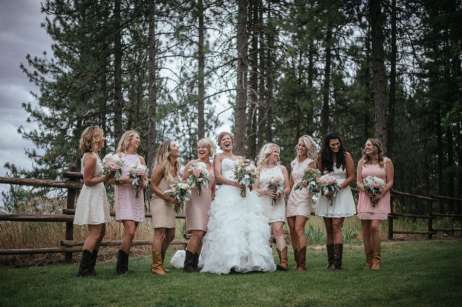 Matt Shumate Photography at The Ridge at Rivermere wedding venue bride and bridesmaids portrait laughing, light pink lacy dresses, cowboy boots