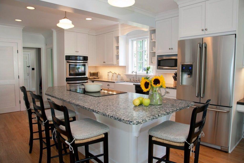 Marblecountertopwithsunfloweronkitchenislandwithseating New Center Island Designs For Kitchens Set