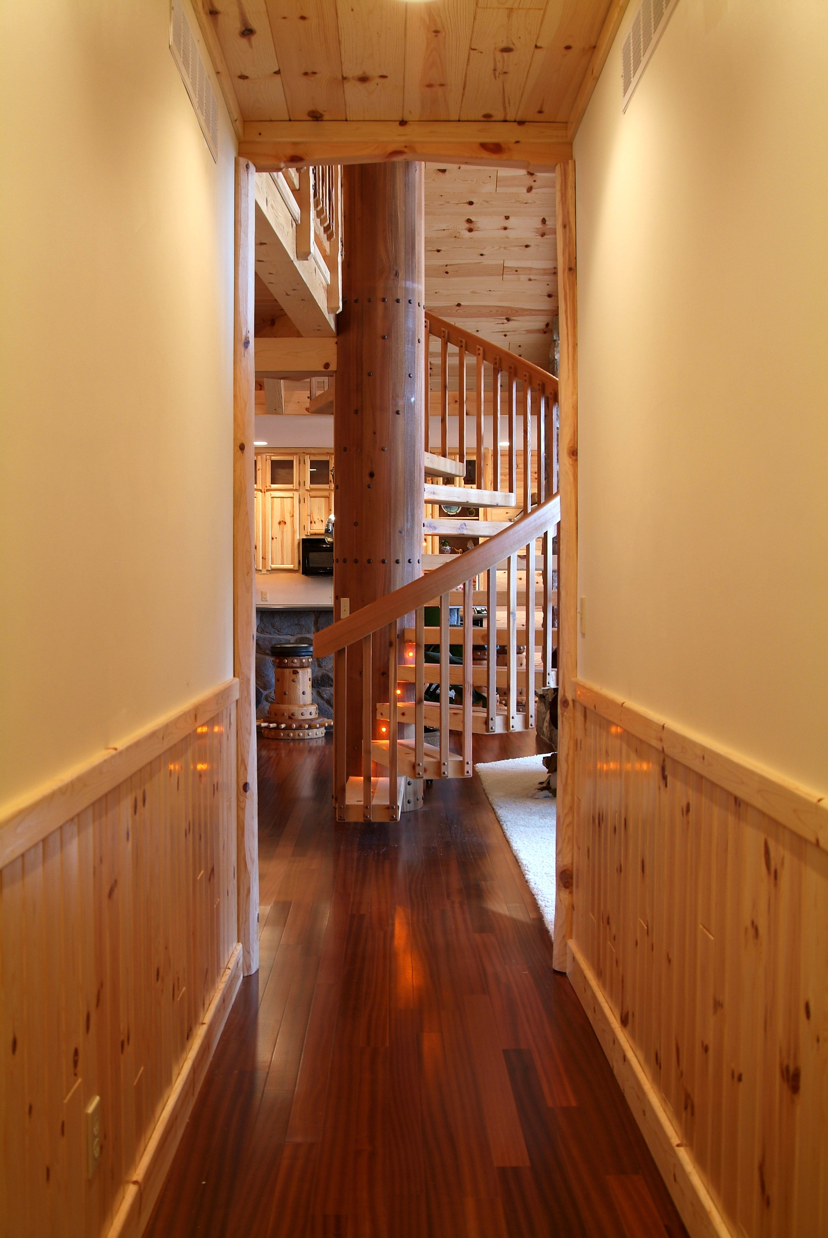 Hallway With Vertical Knotty Pine Paneling And Spiral Staircase Knotty Pine Walls Knotty Pine Paneling Wood Wainscoting