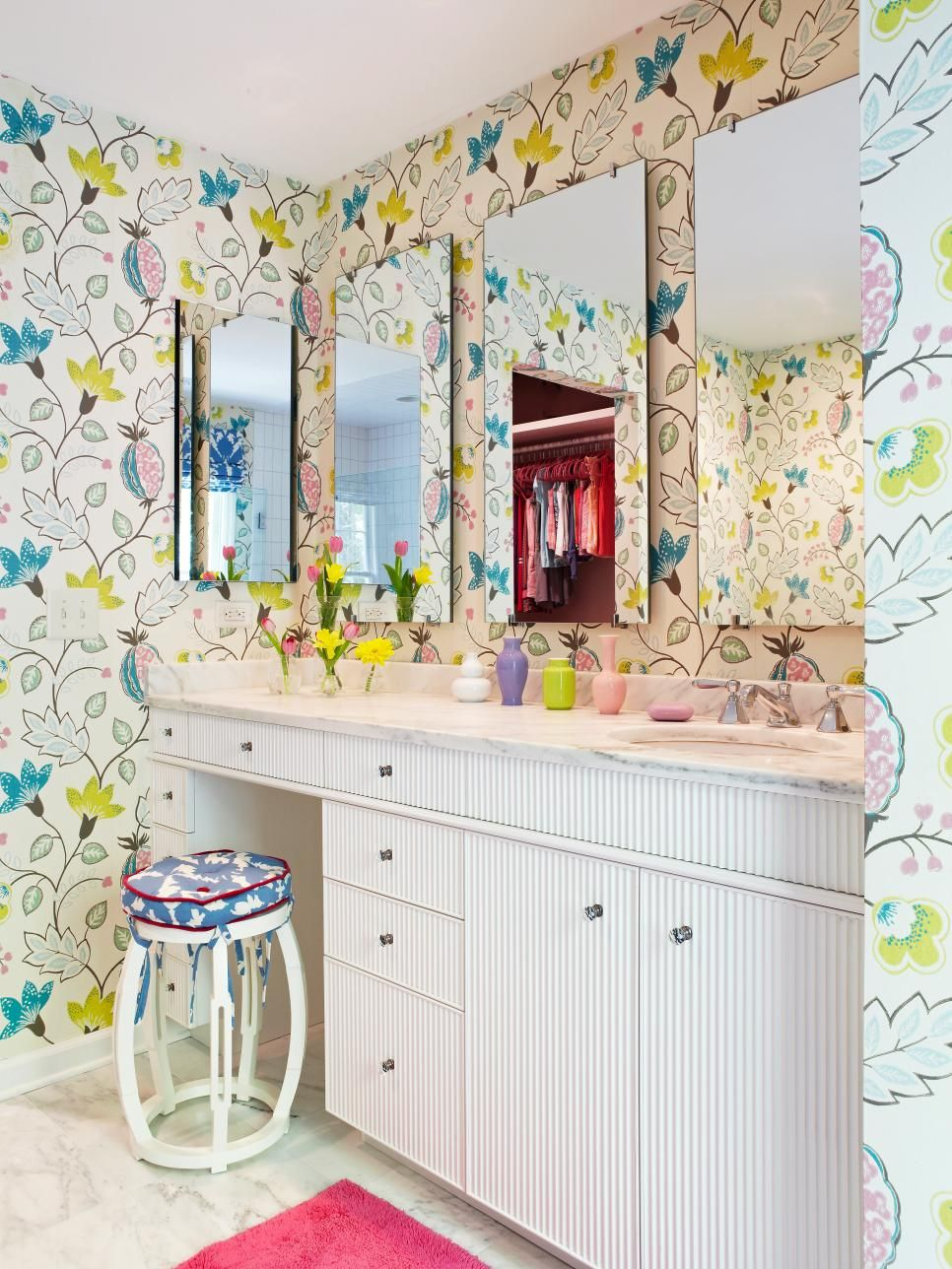 Girly bathroom with fun and colorful wallpaper.