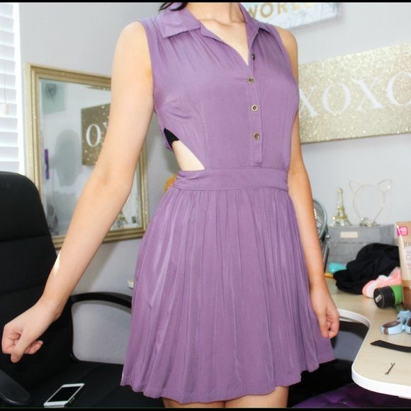 Purple Cut Out Dress It's a dark color, nothing wrong with it! The sides are cut out and it has a little collar at the neck! Purchased this dress at Nordstrom! Black Poppy Dresses