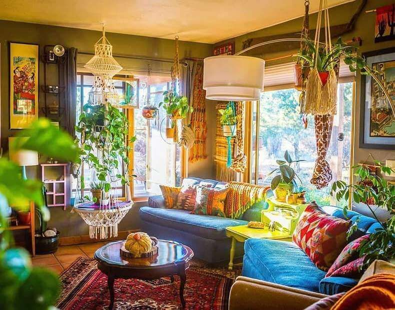 Light Up A Neutral Space With Colorful Furniture Hanging Plant Pots And Lanterns Are A Ge Bohemian Style Living Room Bohemian Style Living Hippie Living Room