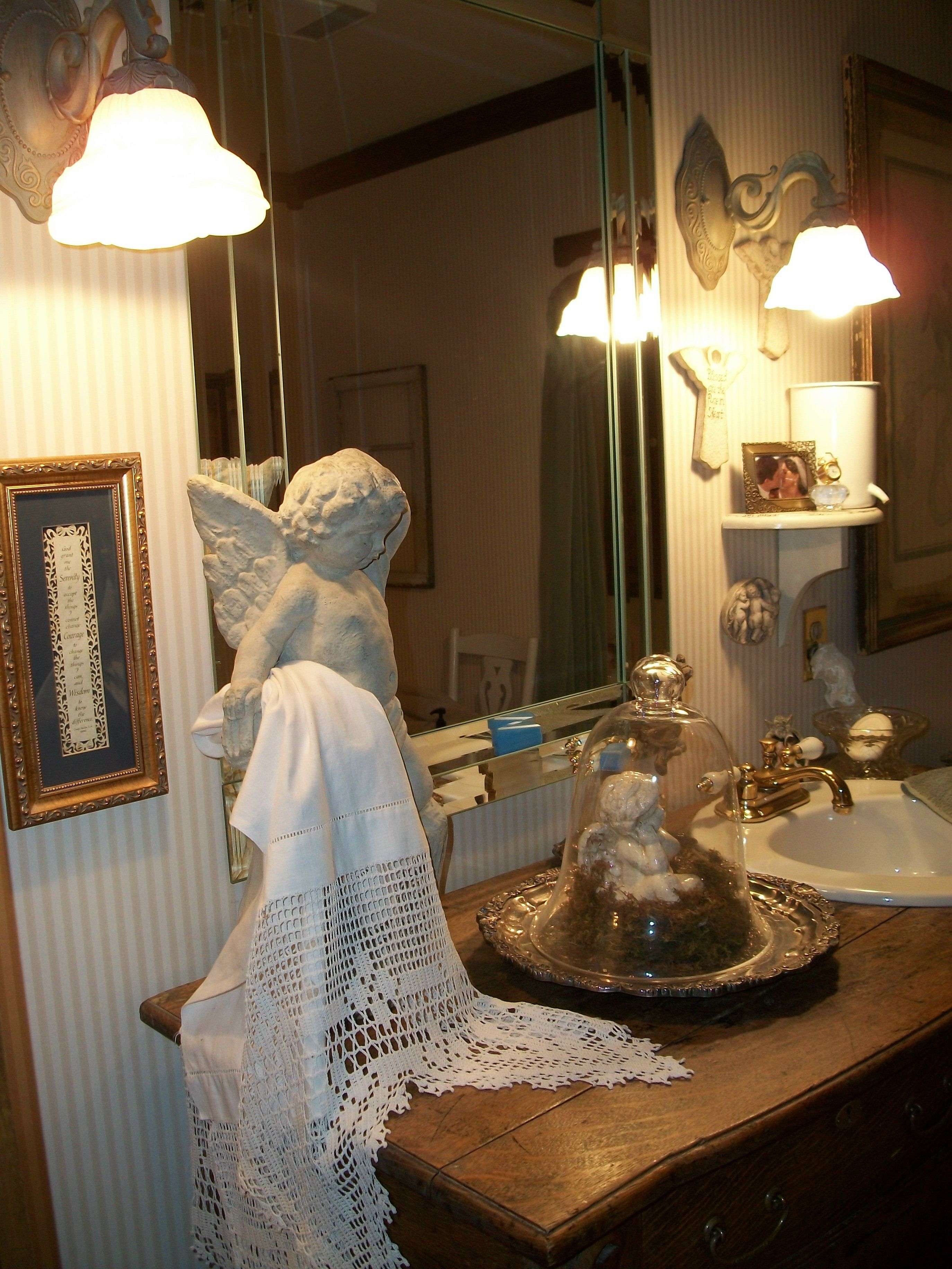 Antique Sideboard for sink, concrete angel, crochet scarf, cloche on antique silver tray.