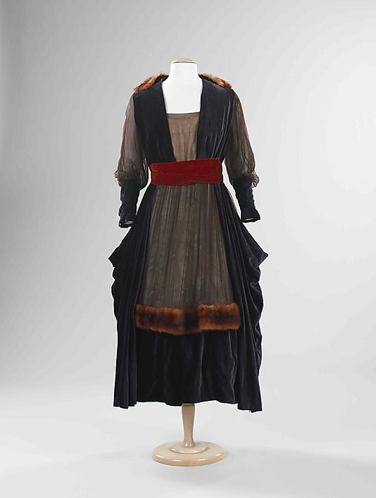 This evening dress by Marguerite reflects the transitional period around 1915 when dressmaking included a mix of materials. Here chiffon, fur, and velvet are used. The silhouette shows the popular pannier shape of the time. Although a variety of textiles were employed, the design is less complex than the embellished work of the Belle Époque.