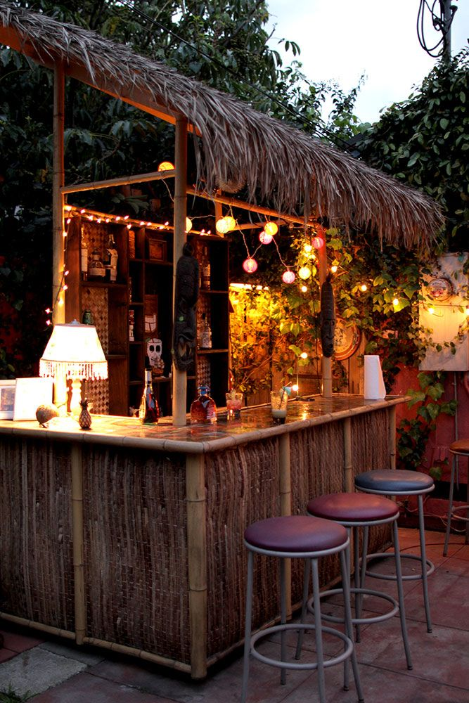 The tiki torture tiki pinterest tiki bars bar and for Beach hut decoration items
