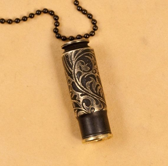 Time capsule necklace - etched bullet casing pendant - This beautiful time capsule pendant is made from an etched bullet casing. It is a 458 Socom casing. It has been etched with our new Briar Patch design and is finished in bright brass and near black. A casing is fitted to slide inside and hold your most cherished memories; a love note, thought of the day, favorite saying, or you can just carry a message from Bond, James Bond. The overall length is 1-5/8 plus a crystal/stone and findings…