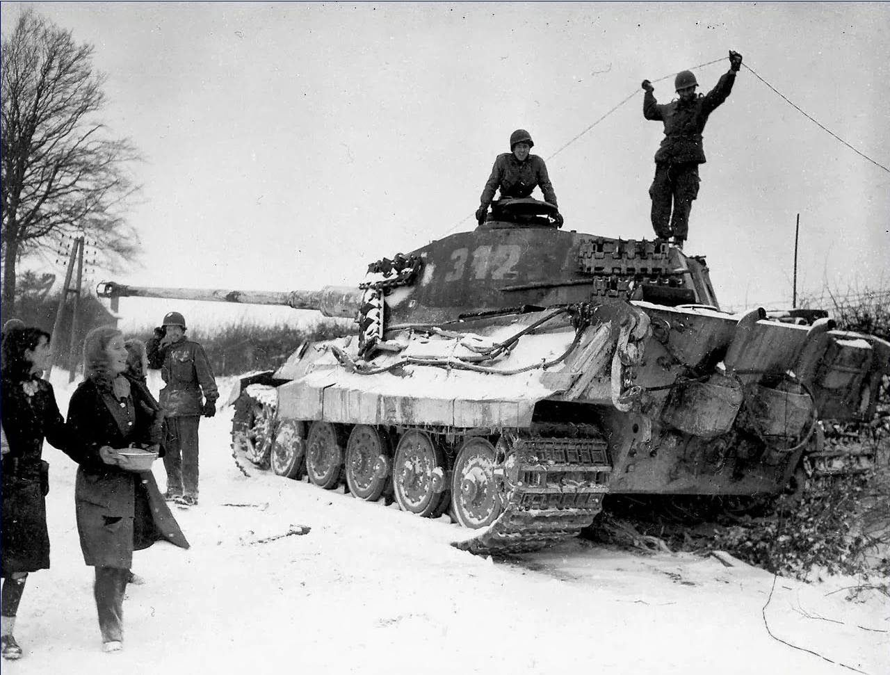 Two American soldiers inspect a destroyed German King ...
