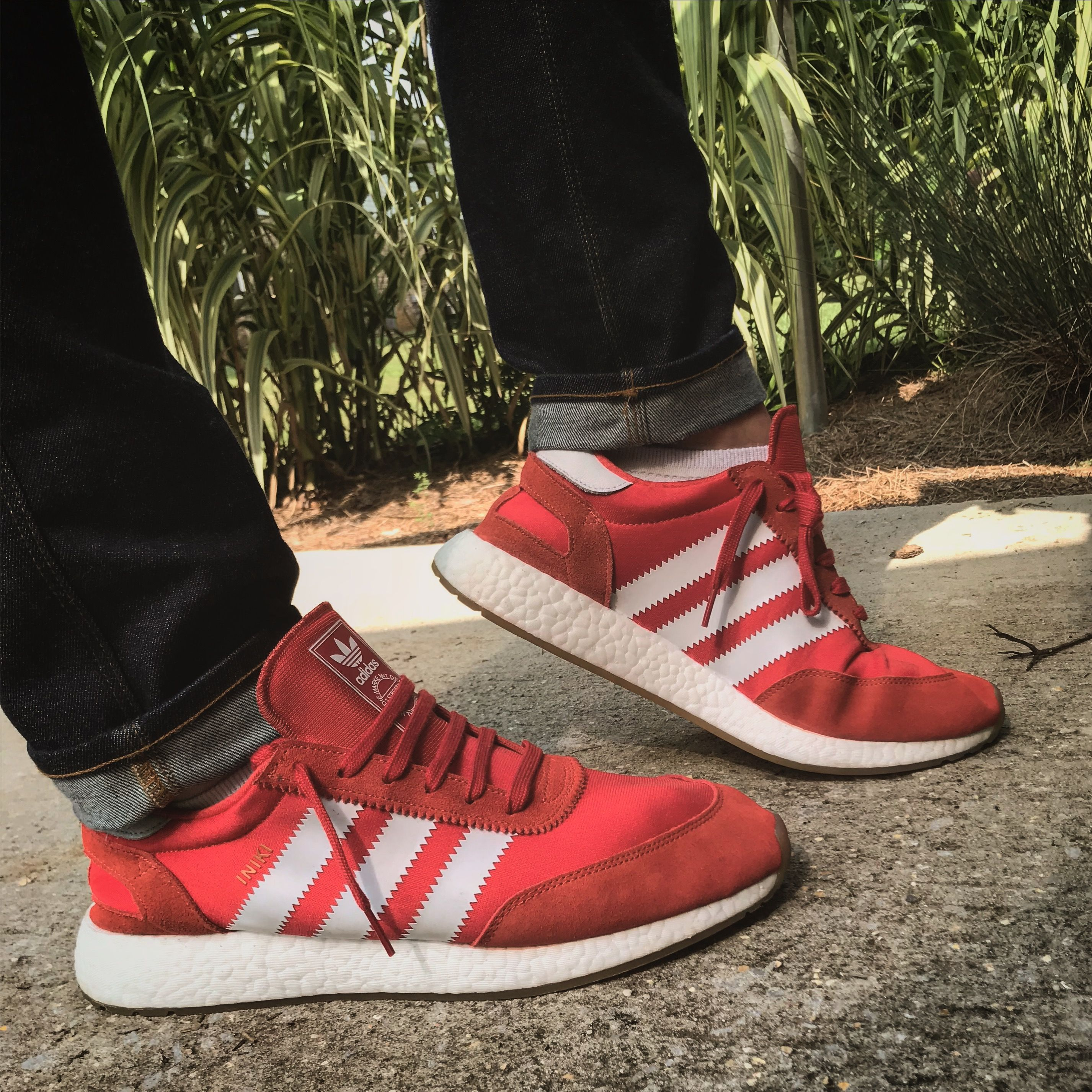 adidas iniki runners in red