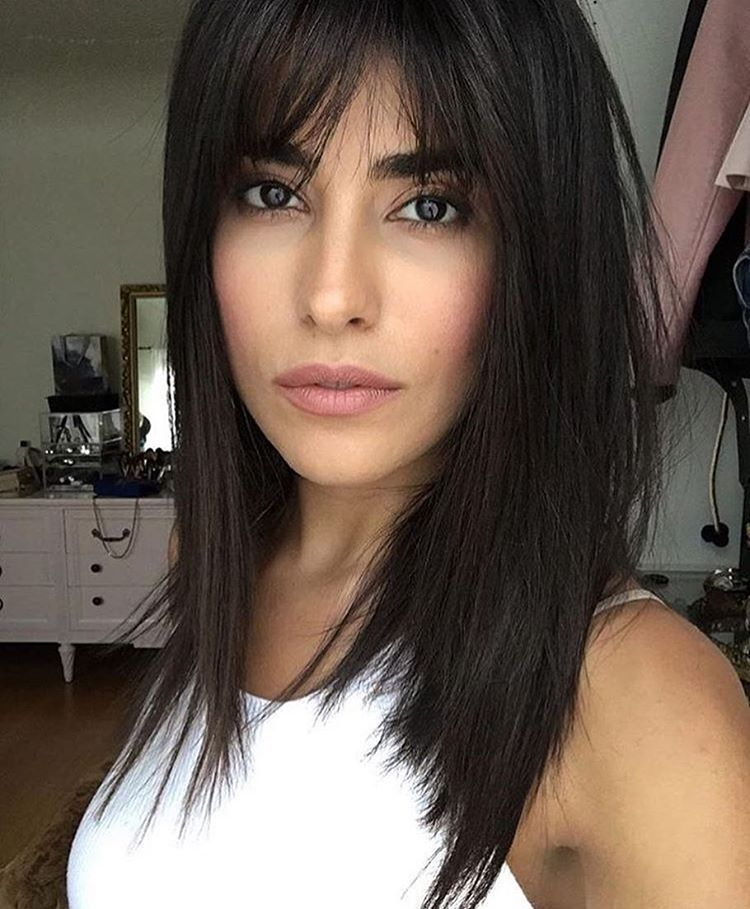 Stick Straight Black Hair With Long Parted Bangs Medium Hair