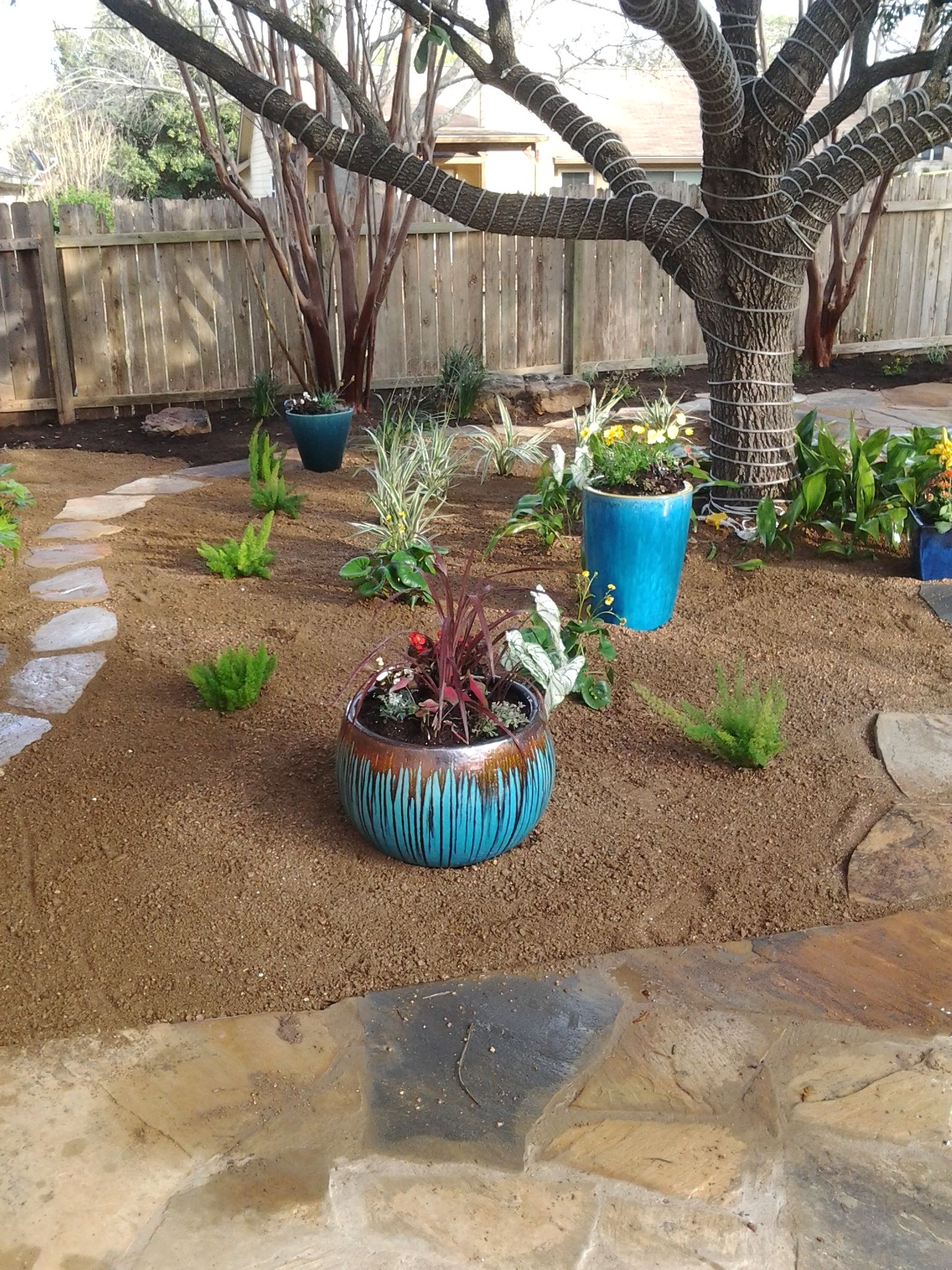 Flagstone patio set in decomposed granite with containers ... on Decomposed Granite Backyard Ideas id=64329