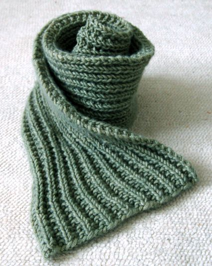 """This Easy Mistake Stitch scarf is made with Jade Sapphire's gorgeous 12-ply cashmere in color """"Green Tea"""". If you know how to knit and purl you can make this scarf! Mistake Stitch creates a deep and lofty rib that looks like so much more work than it actually is.  If you're curious about the orange scarf on the right, you can find the complete instructions at this link:  Lovely Leaf Lace Scarf"""