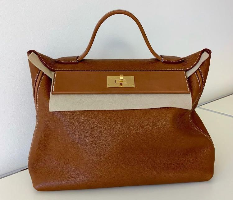Hermes 24 24 bag Color  Gold with gold hardware Leather Barenia  Bag is  come in full set with original store receipt e5efb1af73537