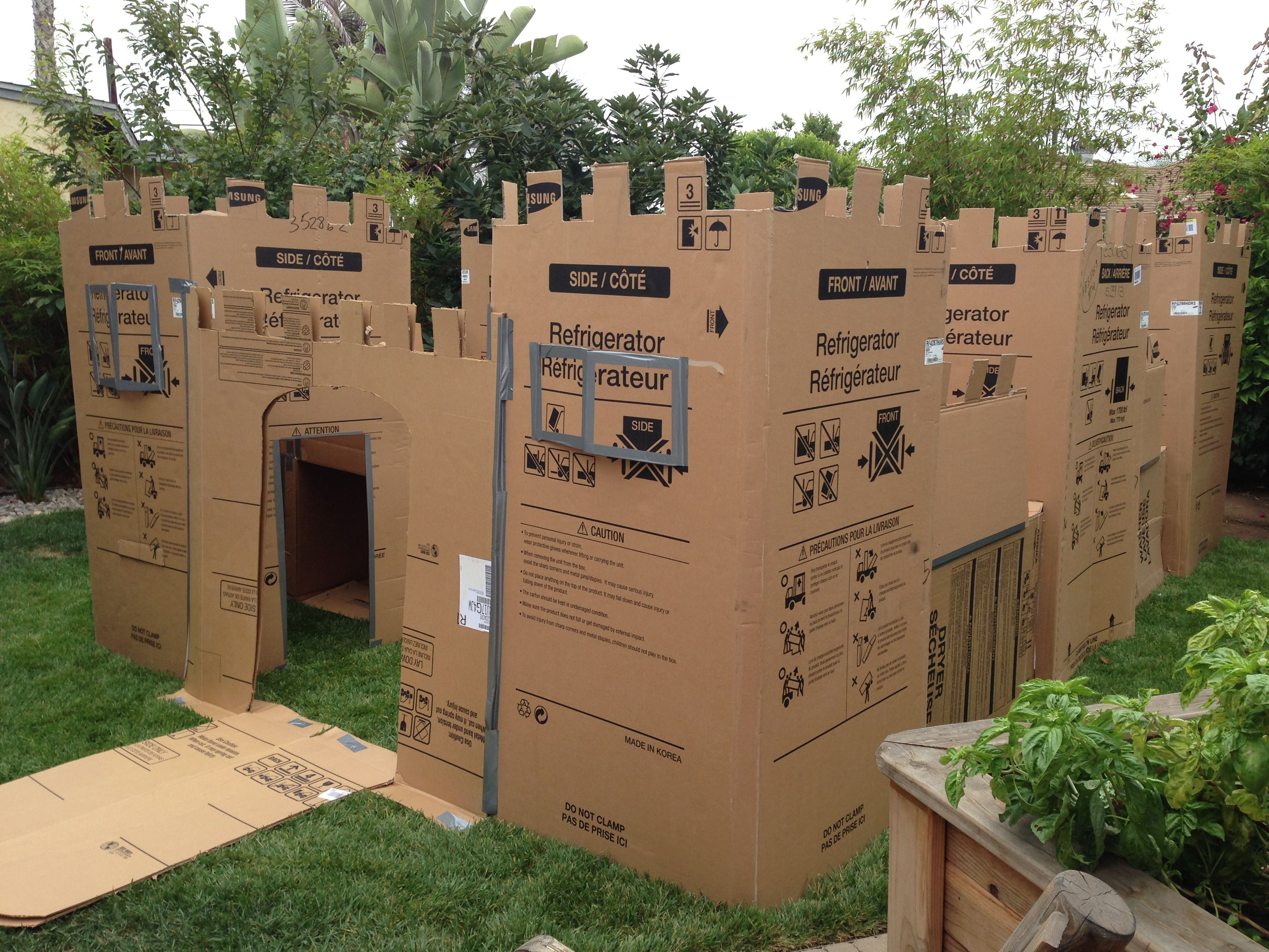 Cardboard fort i created for my sons 1st birthday party for Castle made out of cardboard boxes