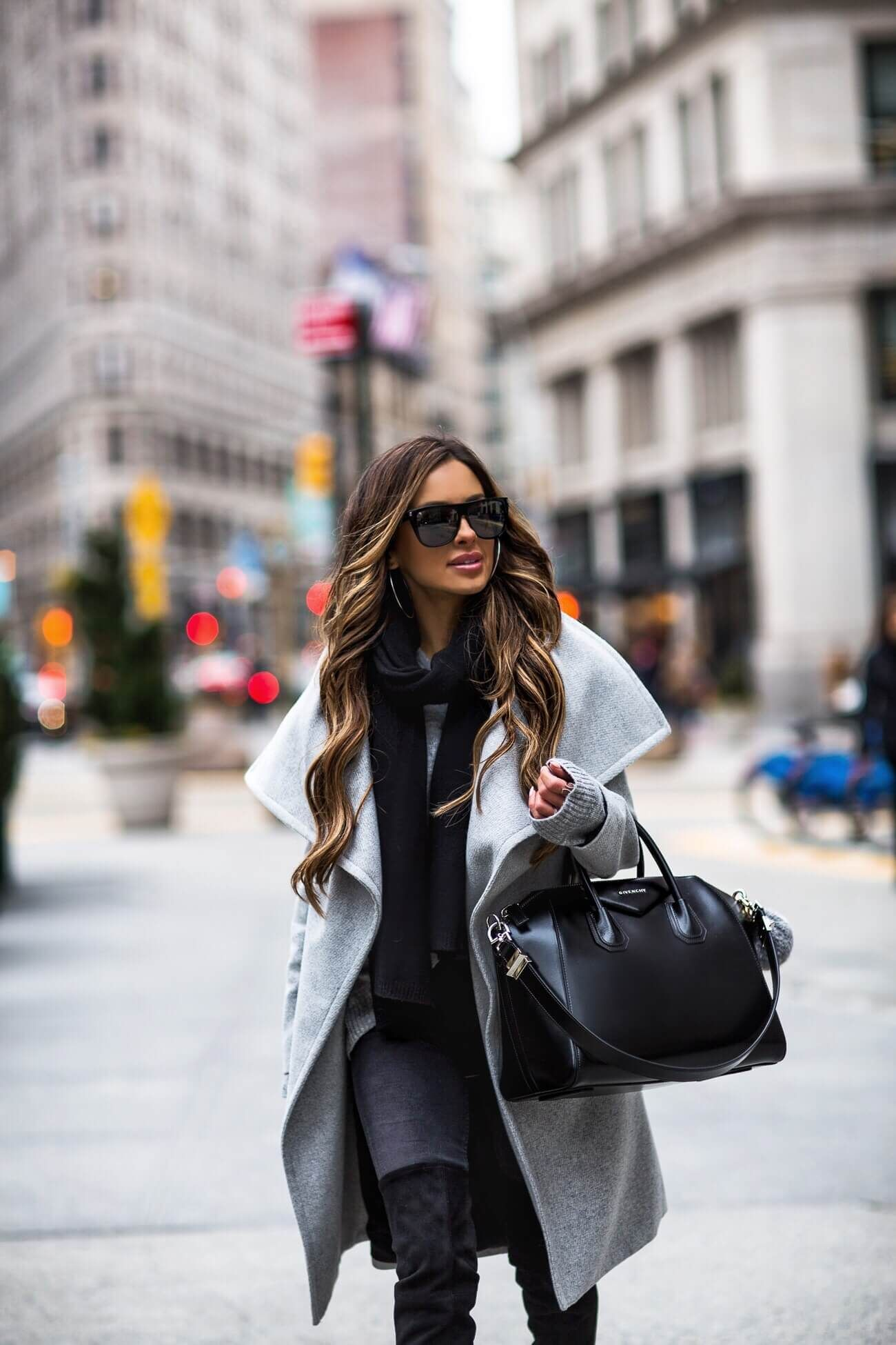 fashion blogger mia mia mine wearing a gray coat and black