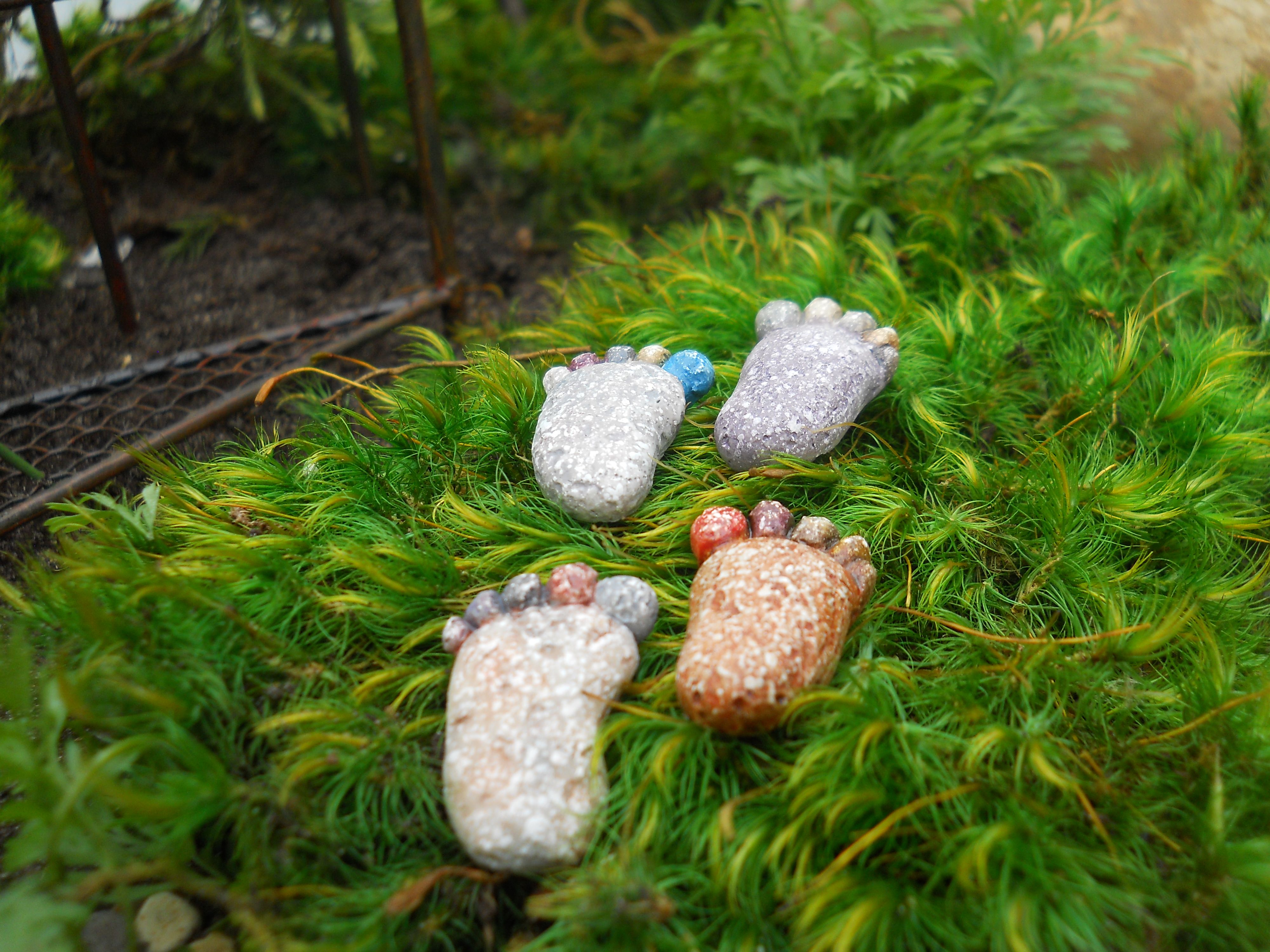 A set of four tiny footprint stepping stones to guide your fairies home.