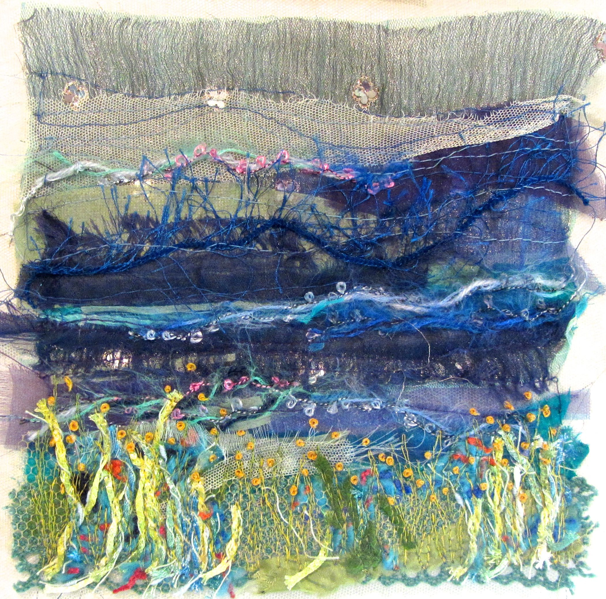 "Created with fabrics, fibres, threads, free motion stitching and water soluble stabilizer. 6"" x 6"" ""Sea Side"""